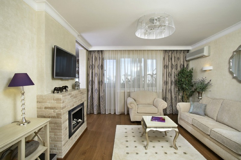 Дизайн гостиной в квартире с камином фото